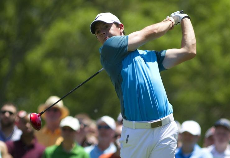 May 4, 2014; Charlotte, NC, USA; Rory McIlroy tees off on the fourth hole during the final round of the Wells Fargo Championship at Quail Hollow Club.