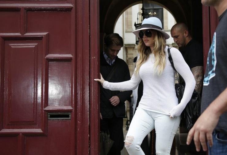 Television Personality Khloe Kardashian Leaves an Apartment Building in Paris