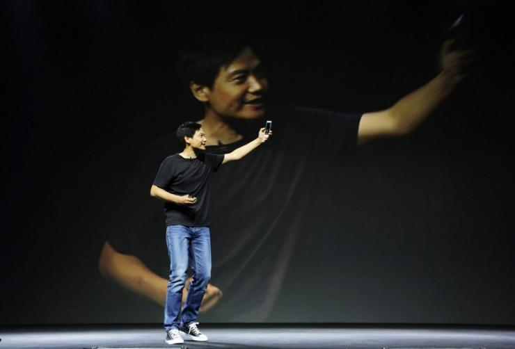 Lei Jun, founder and CEO of China's mobile company Xiaomi, shows new features at launch ceremony of Xiaomi Phone 4 in Beijing