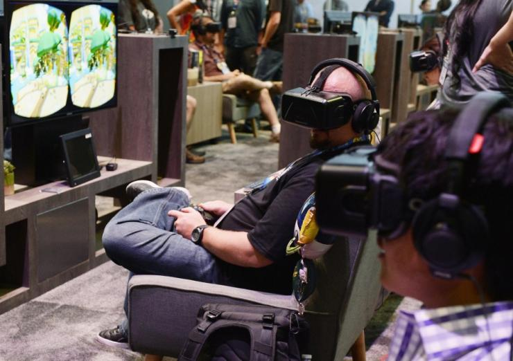 ac538c3cf2f An Attendee Tries On The Oculus VR Inc. Rift Development Kit 2 Headset At  The