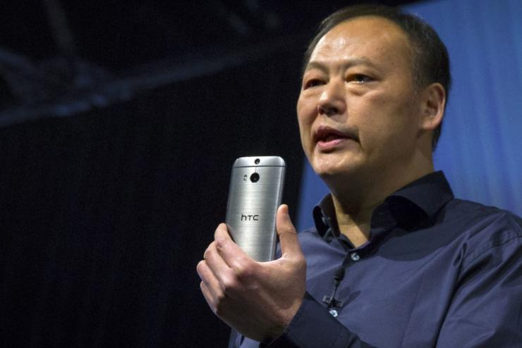 HTC CEO Peter Chou shows the new HTC One M8 phone