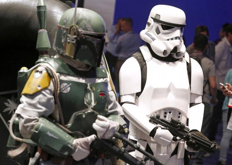 People Dressed As 'Star Wars' Characters Boba Fett, Left, And A Stormtrooper.