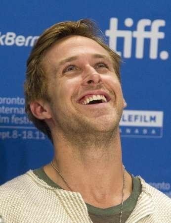 "Actor Ryan Gosling reacts at a news conference for the film ""The Ides of March"" at the 36th Toronto International Film Festival September 9, 2011."