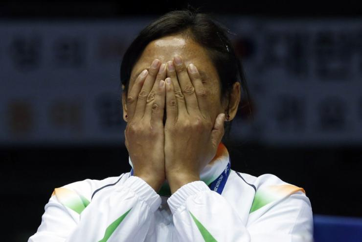 India's bronze medallist Laishram Sarita Devi reacts