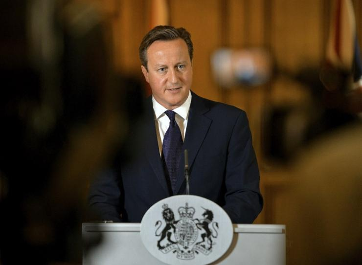 Britain's Prime Minister David Cameron makes a statement to the media