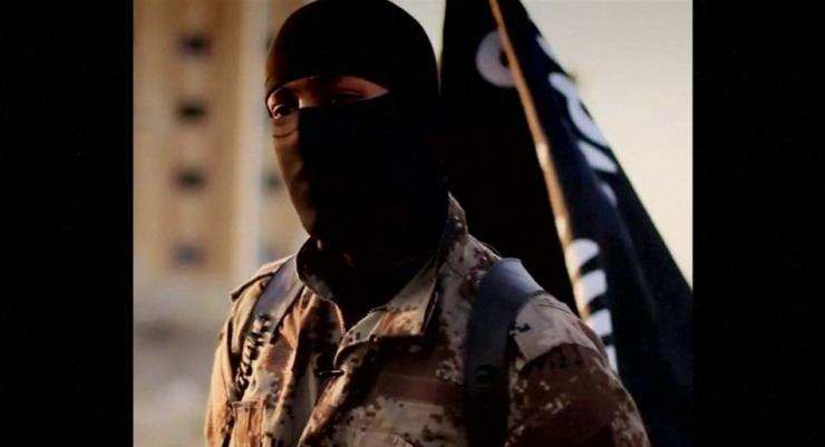 A masked man speaking in what is believed to be a North American accent in a video that Islamic State militants released in September 2014