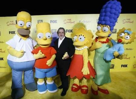Matt Groening (C), creator of The Simpsons, poses with characters
