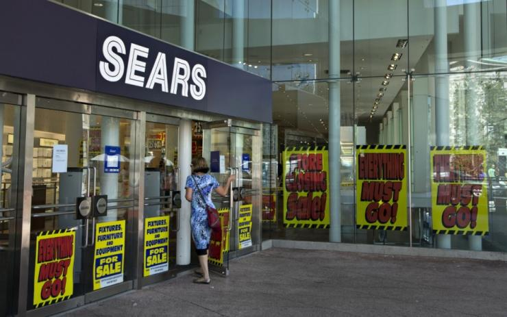 A customer enters the closing down Sears store