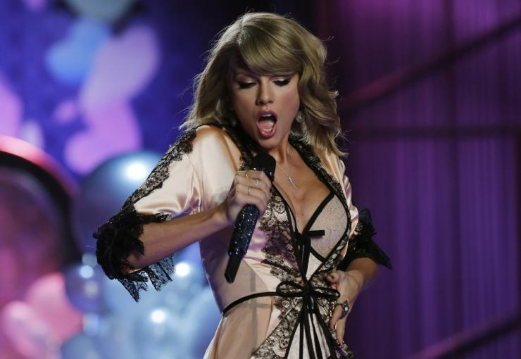 c2b72d05178 Singer Taylor Swift performs during the 2014 Victoria's Secret Fashion Show  in London December 2,