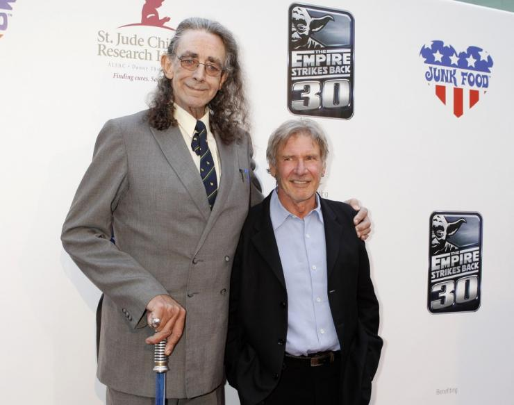 "Original cast members Peter Mayhew (L), who portrayed ""Chewbacca,"" and Harrison Ford, who portrayed Han Solo, attend a screening commemorating the 30th anniversary of ""Star Wars: Episode V The Empire Strikes Back"""