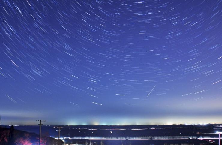 A meteor streaks past stars during the annual Quadrantid meteor shower in Qingdao, Shandong province, January 4, 2014. Picture taken with a long exposure. Picture taken January 4, 2014.