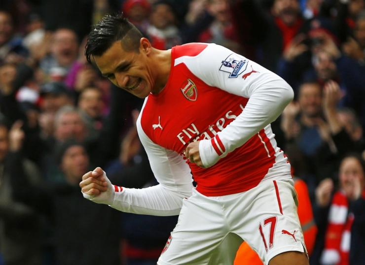 Arsenal's Alexis Sanchez celebrates after scoring his second goal during their English Premier League soccer match against Stoke City at the Emirates Stadium in London January 11, 2015.