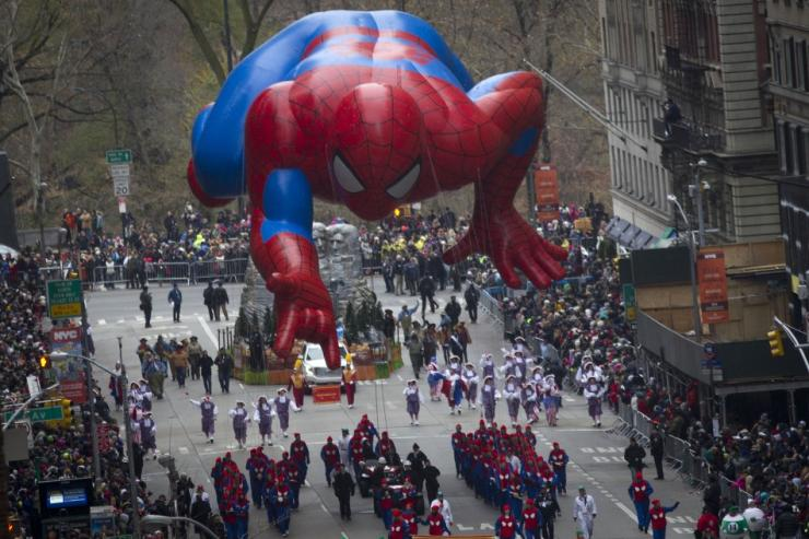 IN PHOTO: The Spiderman float makes its way down 6th Ave during the Macy's Thanksgiving Day Parade in New York November 27, 2014.