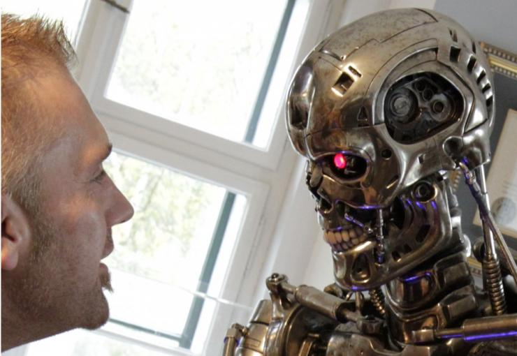 A visitor looks at a robot figure from the movie 'the Terminator'