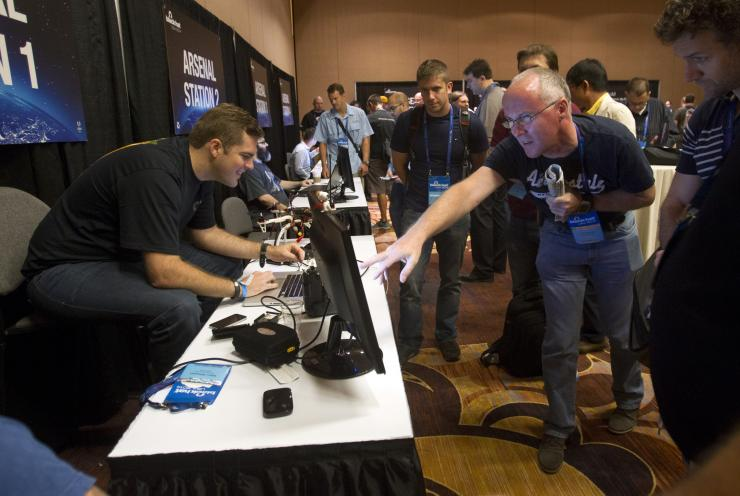 Glenn Wilkenson (L) Of Information Security Company SensPost During The Black Hat USA 2014 Hacker Conference