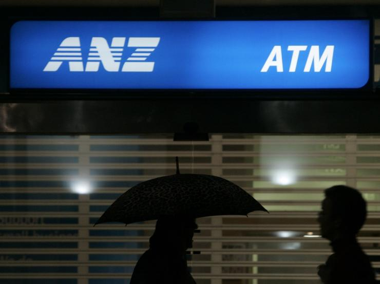 Office workers pass an ANZ Bank sign in central Sydney April 24, 2008.