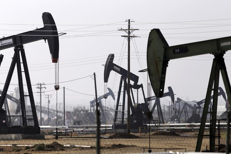 Oil drills are pictured in the Kern River oil field in Bakersfield, California November 9, 2014.