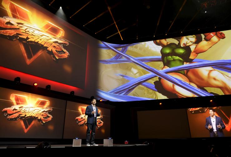 "Asad Qizilbash, Senior Director of Brand Marketing at Sony Computer Entertainment America, introduces the video game ""Street Fighter V"" at the Sony Playstation E3 conference in Los Angeles, California June 15, 2015."