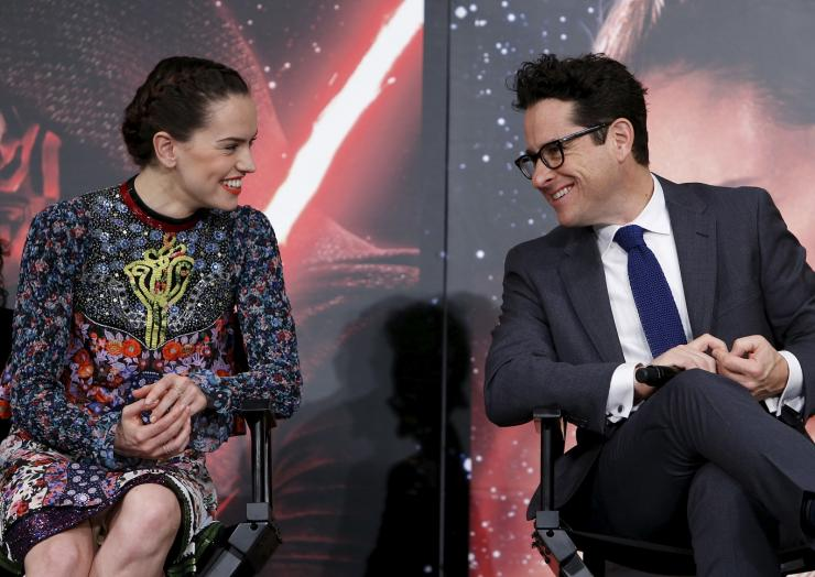 "Director J.J. Abrams (R) and cast member Daisy Ridley have a chat during a news conference for their upcoming movie ""Star Wars: The Force Awakens"" in Urayasu, Chiba prefecture, the suburbs of Tokyo, Japan, December 11, 2015."