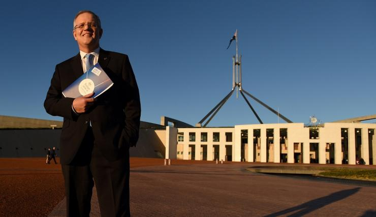 Australian Federal Treasurer Scott Morrison stands outside Australia's Parliament House in Canberra May 4, 2016 following the announcement  Australia's 2016-17 Federal Budget.
