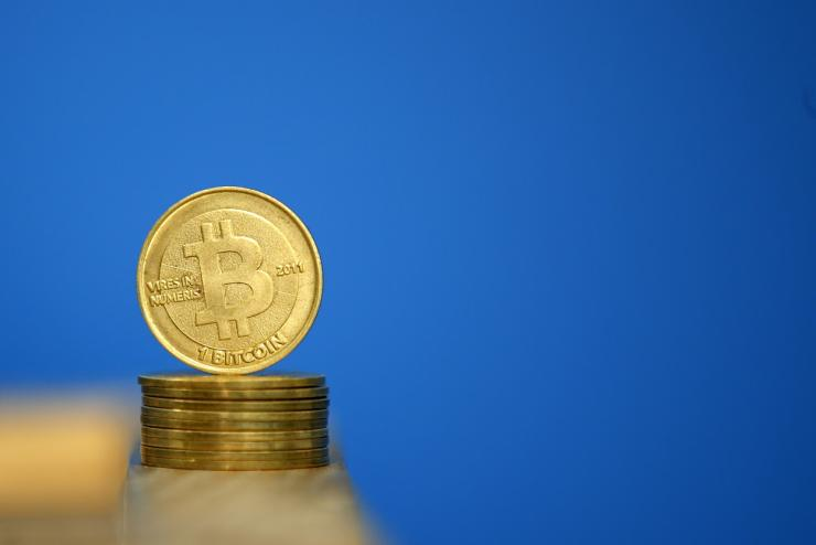 Bitcoin (virtual currency) coins are seen in an illustration picture taken at La Maison du Bitcoin in Paris July 11, 2014.