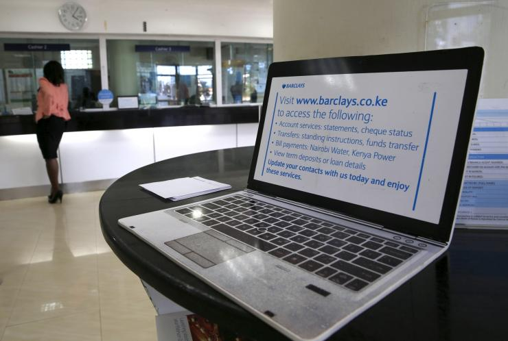A dummy laptop with online banking instructions is placed inside the banking hall within the Barclays Bank Kenya head offices in the capital Nairobi, March 1, 2016.