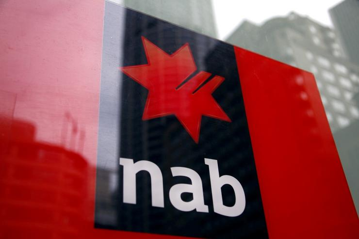 A National Australia Bank (NAB) logo is pictured on an automated teller machine (ATM) in central Sydney September 12, 2014.