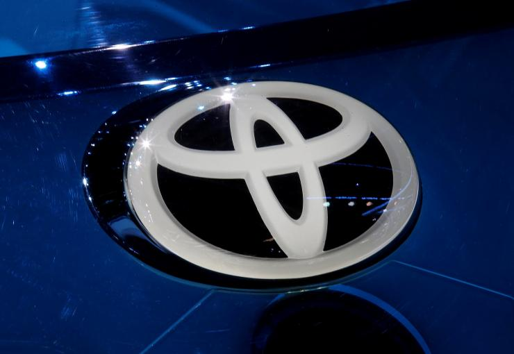 A Toyota logo is seen on media day at the Mondial de l'Automobile, the Paris auto show, in Paris, France, September 29, 2016.