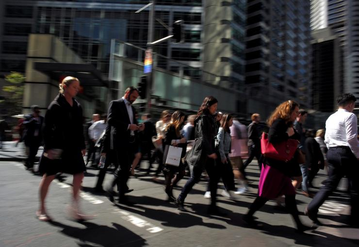 Office workers and shoppers walk through Sydney's central business district in Australia, September 7, 2016.