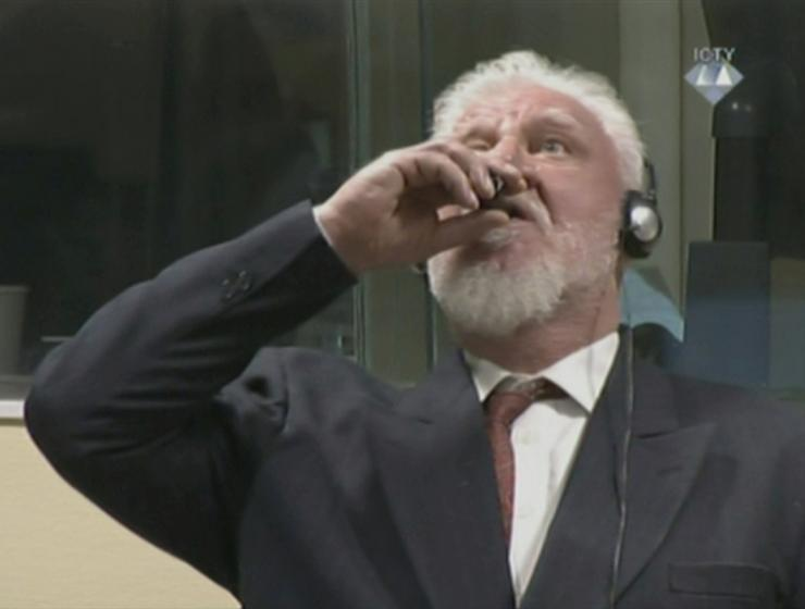 A wartime commander of Bosnian Croat forces, Slobodan Praljak, is seen during a hearing at the U.N. war crimes tribunal in the Hague, Netherlands, November 29, 2017.