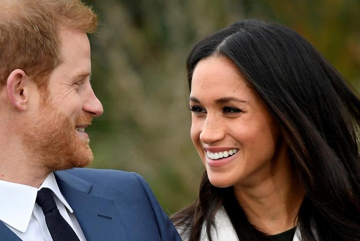 Britain's Prince Harry poses with Meghan Markle
