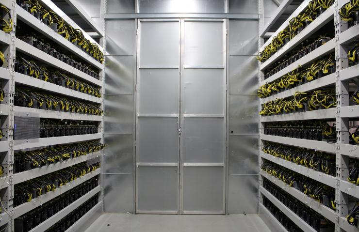 FILE PHOTO: An interior view of Chinese bitcoin mining company Bitmain's mining farm near Keflavik, Iceland, June 4, 2016.