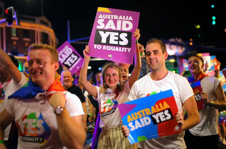 Participants hold banners regarding same-sex marriage during the 40th anniversary of the Sydney Gay and Lesbian Mardi Gras Parade in central Sydney, Australia March 3, 2018.