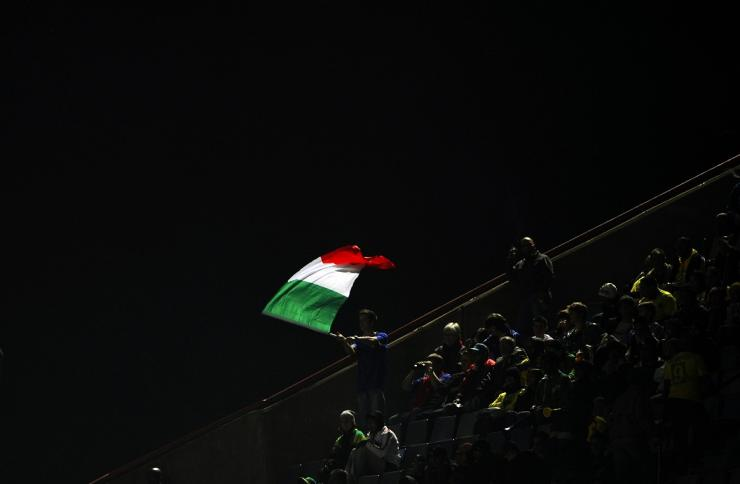 A fan waves the Italian national flag before his team take on Brazil in their Confederations Cup soccer match at the Loftus Versfeld stadium in Pretoria June 21, 2009.