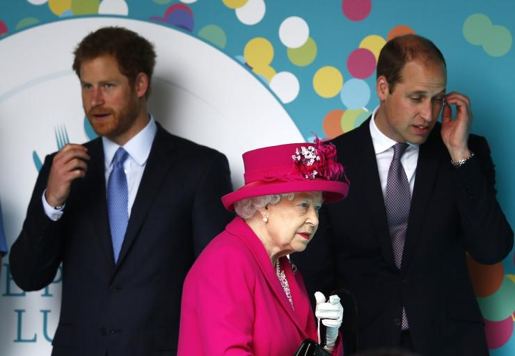 Britain's Queen Elizabeth prepares to speak as Prince William, and Prince Harry (L)