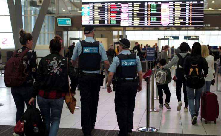 Australia Federal Police officers patrol the security lines at Sydney's Domestic Airport in Australia, July 31, 2017,