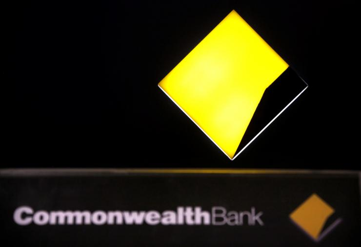 FILE PHOTO: A Commonwealth Bank logo adorns an Automatic Tellar Machine (ATM) located in Sydney, Australia November 12, 2014.