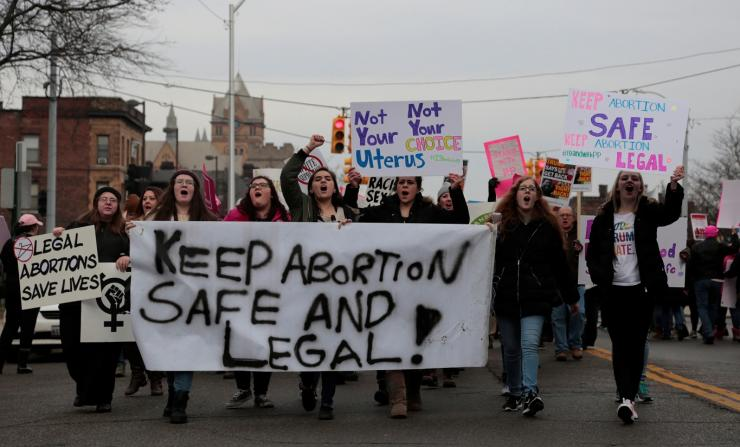 Supporters of Planned Parenthood rally outside a Planned Parenthood clinic in Detroit, Michigan, U.S. February 11, 2017.