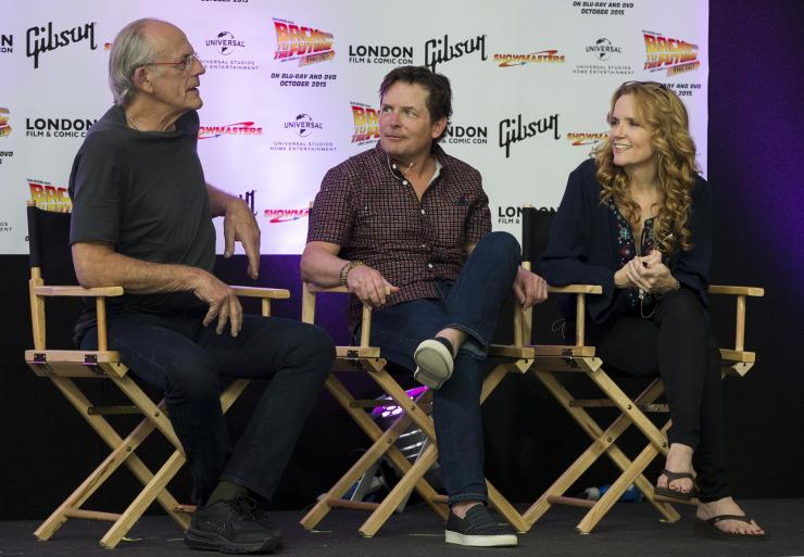 "Actors Christopher Lloyd (l), Michael J Fox (c) and Lea Thompson (r) attend a media conference for the 30th anniversary of their film ""Back to the Future"" at the London Film and Comic-Con in London, Britain July 17, 2015."
