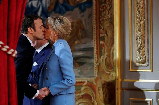 French President Emmanuel Macron kisses his wife Brigitte Trogneux