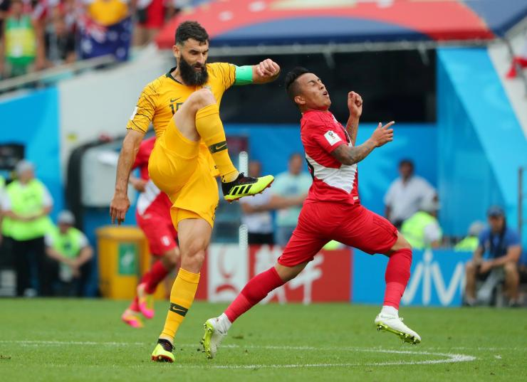 Soccer Football - World Cup - Group C - Australia vs Peru - Fisht Stadium, Sochi, Russia - June 26, 2018   Australia's Mile Jedinak in action with Peru's Christian Cueva