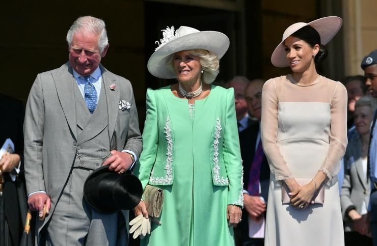 Meghan, Duchess of Sussex attends a garden party at Buckingham Palace, with Camilla the Duchess of Cornwall and Prince Charles, in London, Britain May 22, 2018.