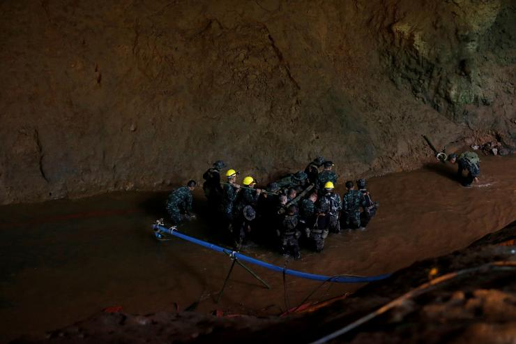 Soldiers and rescue workers work in Tham Luang cave complex,