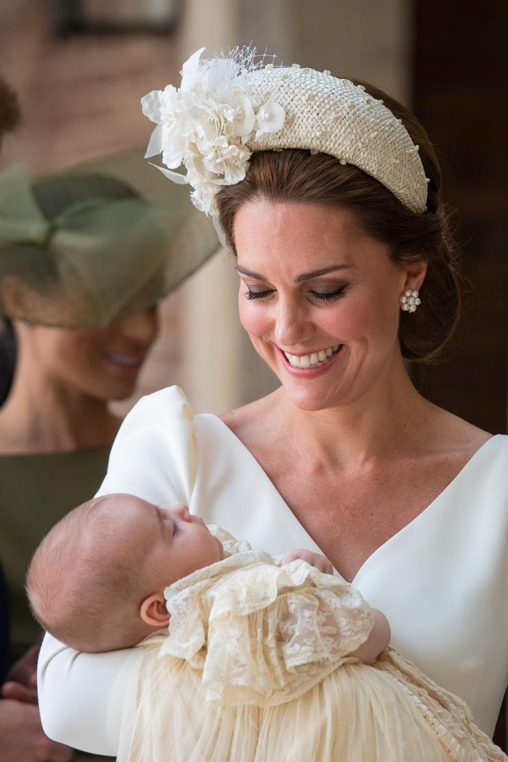 Britain's Catherine, the Duchess of Cambridge, carries Prince Louis