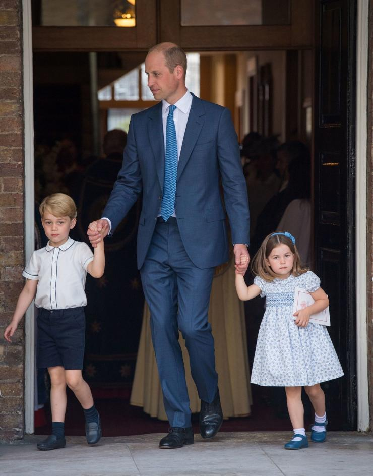 Britain's Prince William and Catherine, the Duchess of Cambridge, leave the chapel with their children Prince George, Princess Charlotte and Prince Louis