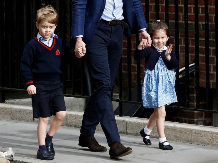 Britain's Prince William arrives at the Lindo Wing of St Mary's Hospital with his children Prince George and Princess Charlotte after his wife Catherine, the Duchess of Cambridge, gave birth to a son, in London, April 23, 2018.