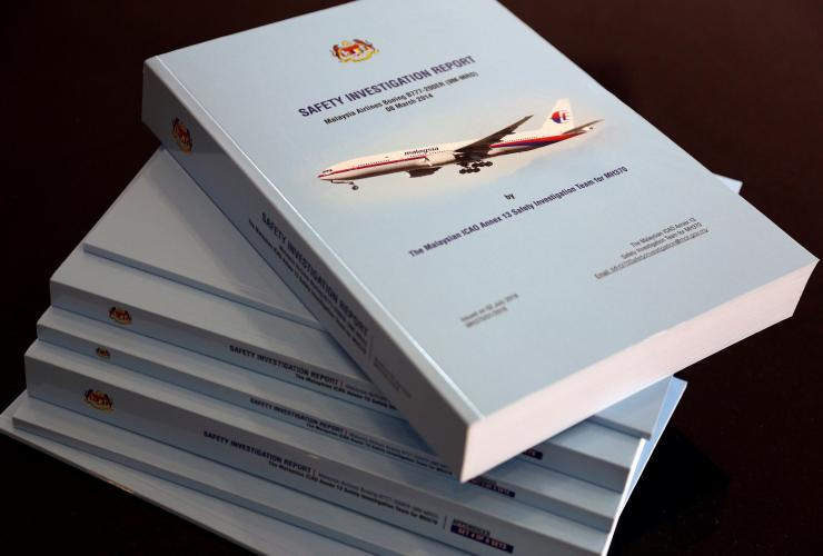 A stack of MH370 safety investigation report booklets is pictured at a closed door meeting with family members in Putrajaya, Malaysia July 30, 2018.