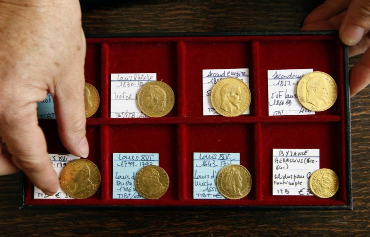 A coin dealer displays gold coins in a shop in Nice, southern France, October 8, 2008.