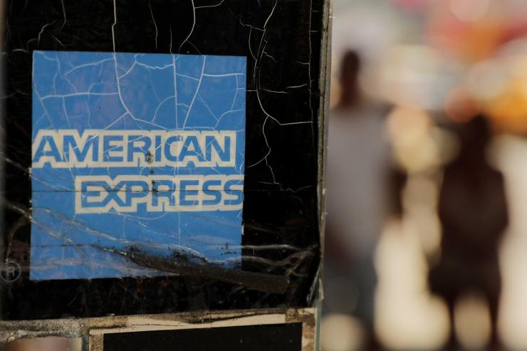 Pedestrians walk past an American Express sign in New York U.S., July 16, 2018.