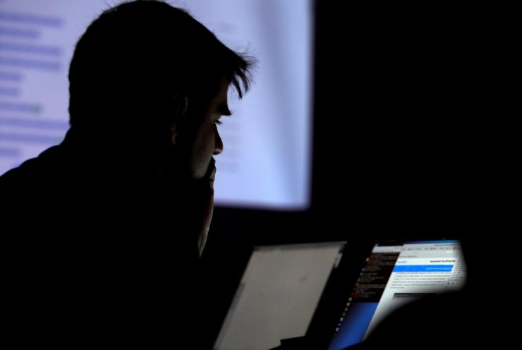 FILE PHOTO: A man takes part in a hacking contest during the Def Con hacker convention in Las Vegas, Nevada, U.S. on July 29, 2017.
